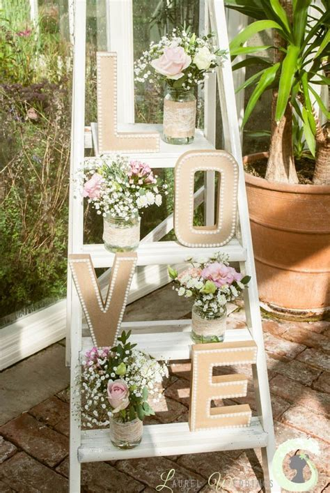Shabby chic ladder decorated with flowers   Jenns wedding