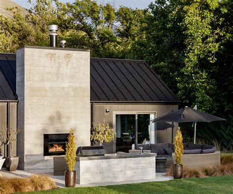 home black this black clad wanaka home brings contemporary style to a