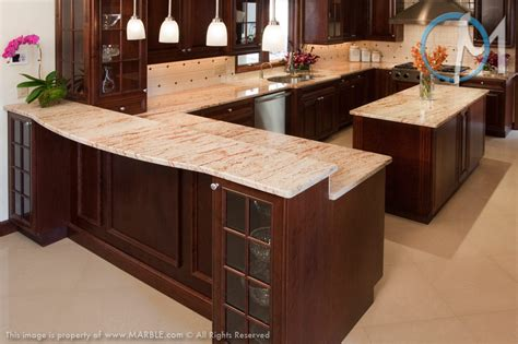 mahogany kitchen cabinets with granite countertops this kitchen shows how well the ivory brown granite can