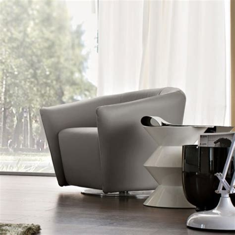 Modern Armchairs Uk by Boutique Swivel Armchair Fabric Or Leather
