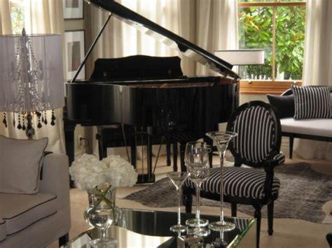 piano in living room living room monochrome inc interior design
