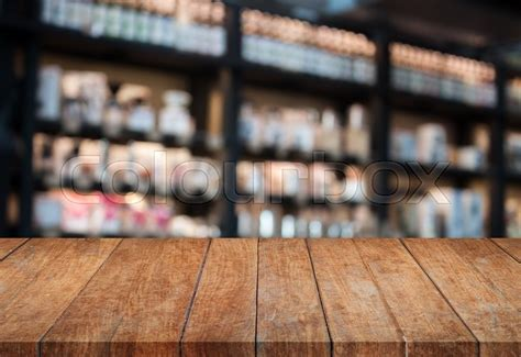 Perspective top wooden table with blurred cafe background