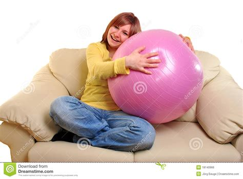 couch ball young woman with a stability ball on a couch royalty free