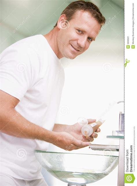 men in bathroom man in bathroom with hair gel stock image image 5930501