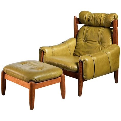 green leather ottoman oak lounge chair and ottoman with green leather cushions