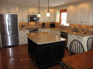 white kitchen cabinets with black island cream kitchen cabinets with black island oak hardwood flooring and what looks like st cecilia