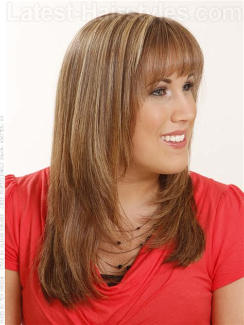 hairstyles with blended bangs long honey brown layered style with bangs side view