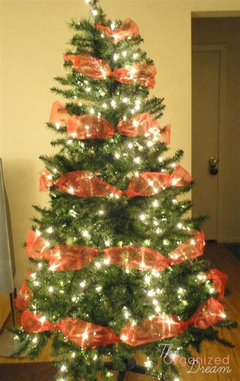 a super easy way to decorate your tree with ribbon that