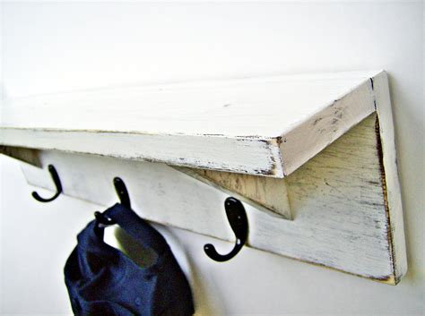 White Shelf With Hooks by Wood Wall Shelf With Hooks Antique White 24 Inch Rustic