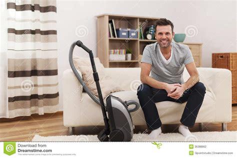 vacuum the living room in everyday s duties stock photo image of vacuum sofa 36388662