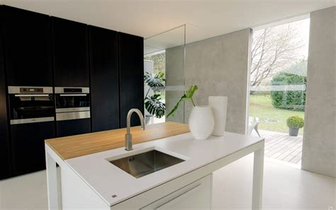 modern minimalist kitchen with hybrid island table worktop