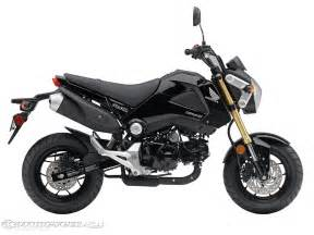 The 2014 honda grom is available in pearl red or metallic black for
