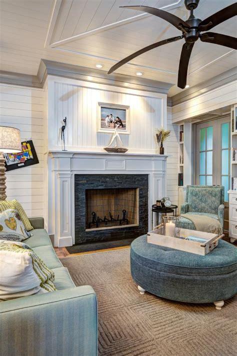 living room  tiled fireplace large ceiling fan