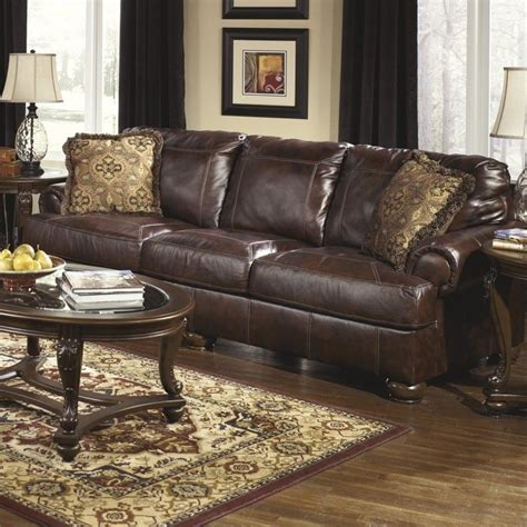 ashley walnut sofa ashley furniture axiom leather sofa in walnut 4200038