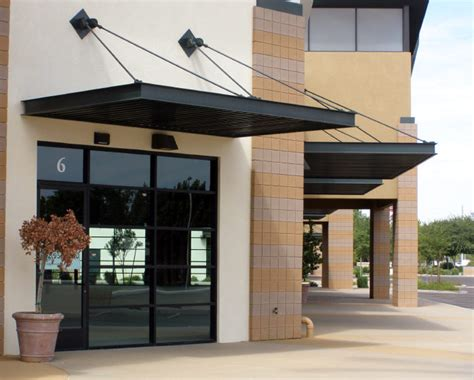 awnings for commercial buildings overhead supports on commercial awnings cool retail
