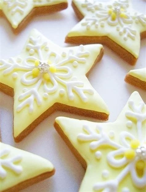 decorative icing fancy star shaped sugar cookies with yellow and white