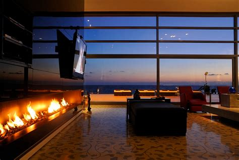 Putting Tv Fireplace by Tv Above Fireplace Design Ideas