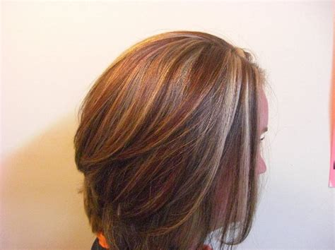 brown hair red tint blode highlights red gold brown blonde highlights stacked bob medium hair