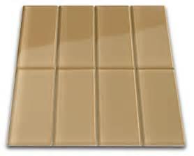 chagne glass subway tile backsplash with white cabinets