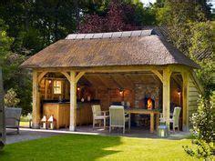van kooten tuin en buitenleven buitenkeuken eiken houten tuinkamer met open haard en loungeset