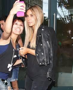 1 kim kardashian fan site pictures bio news kim kardashian flaunts her blonde wig as she poses for