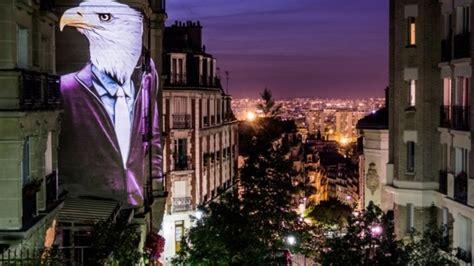 gambar binatang berbadan manusia hiasi bangunan  paris