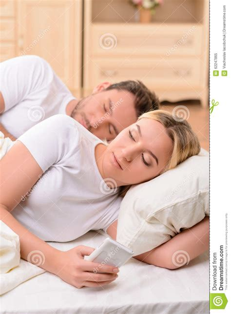 wife in bed husband and wife lying in bed stock photo image 62247865