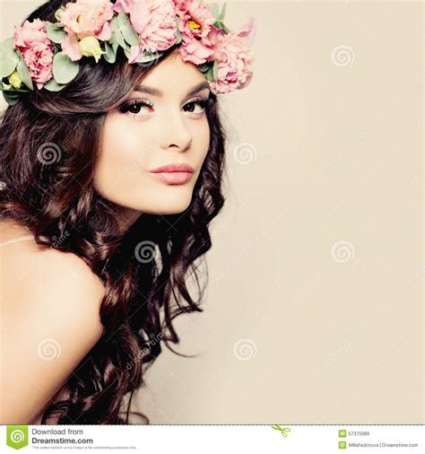 beautiful young woman with summer pink flowers stock image