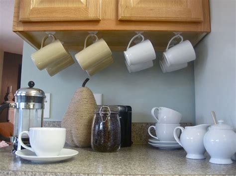 Cabinet Coffee Cup Rack by 10 Ideas To Save Space In The Kitchen Jewelpie