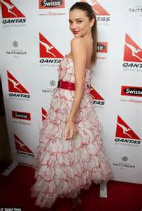 Miranda kerr gives a lesson in how to wear a cocktail dress as she