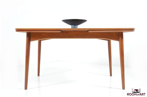 mid century dining table in teak room of