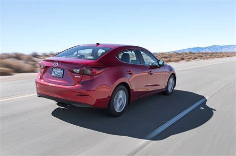 2014 mazda3 rear three quarters in motion photo 31