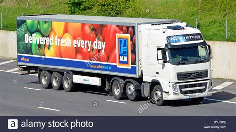 aldi supermarket supply chain delivery trailer volvo truck driving stock photo royalty