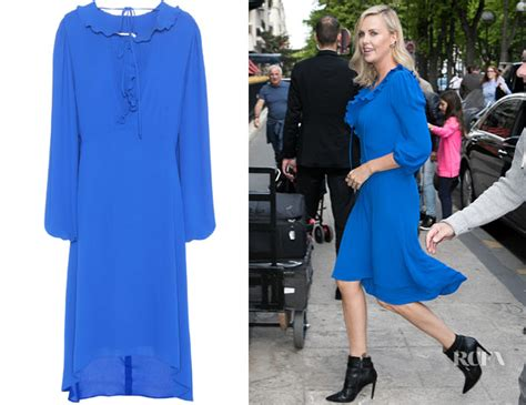 Charlize Theron With And Balenciaga Purses by Charlize Theron S Balenciaga Swing Collar Frill Dress