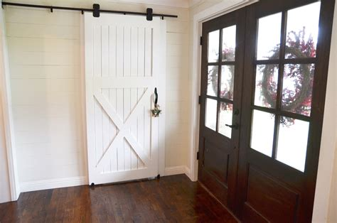 hanging a barn door how to hang a barn door beneath my