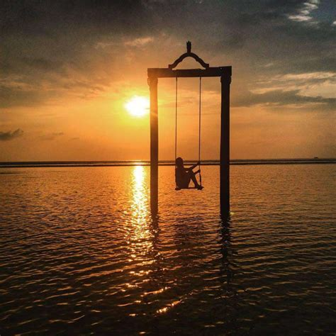 sunset swings this sea swing is one of the world s best spots for sunset