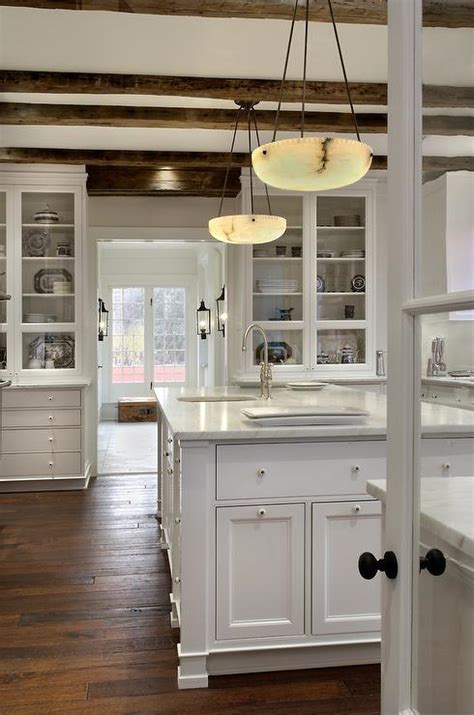 rustic white kitchen cabinets rustic wood beams cottage kitchen donald lococo architects
