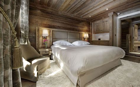 rustic bedroom lighting the chalet cabin to visit when going on a skiing vacation