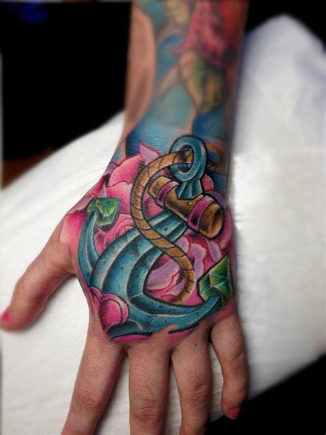 tattoo new school hand new school style colored hand tattoo of roped anchor with