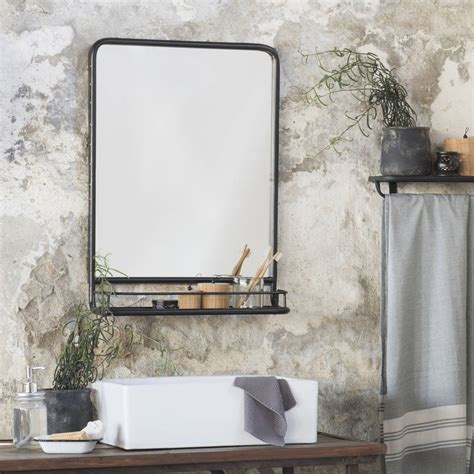 large black industrial mirror with shelf by the