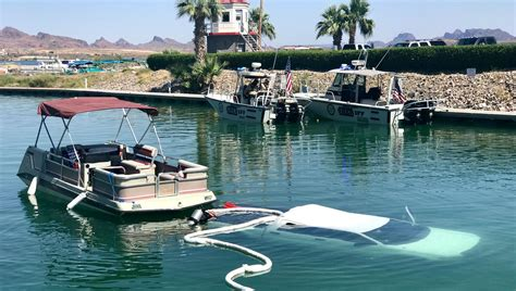 boat lettering in lake havasu city truck submerged in lake havasu only minor injuries