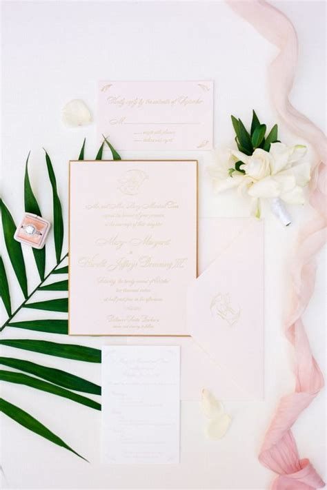 Blush Tropical picture of blush wedding stationery with gold calligraphy and framing for a cool tropical wedding