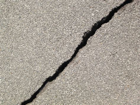 how to repair cracks in a concrete driveway