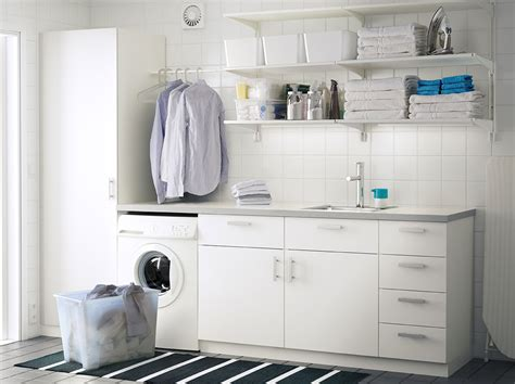 White Wall Cabinet Laundry Room A Laundry Room With White Wall Shelves Base Cabinets With Doors Or Drawers And A High Cabinet