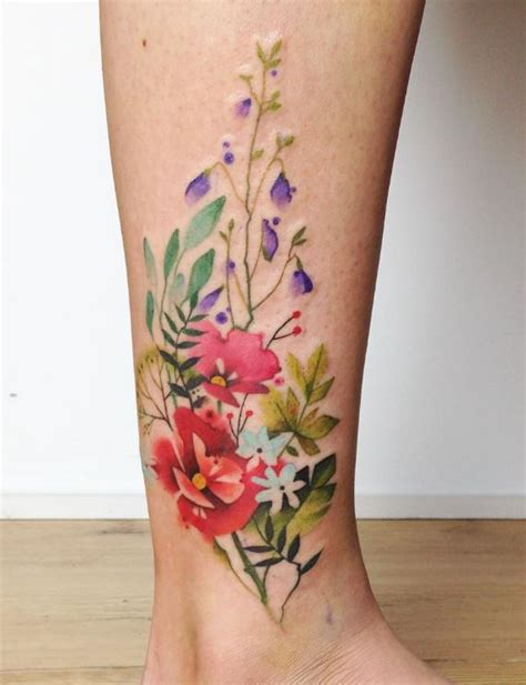 colorful flowers tattoo inkstylemag