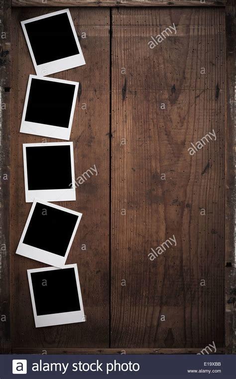 vintage polaroid vintage polaroid frame on wood stock photo royalty free