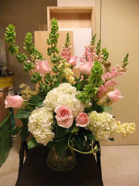 Silk Flower Arrangements For Dining Room Table bells of ireland snap dragon rose stock and hydrangea