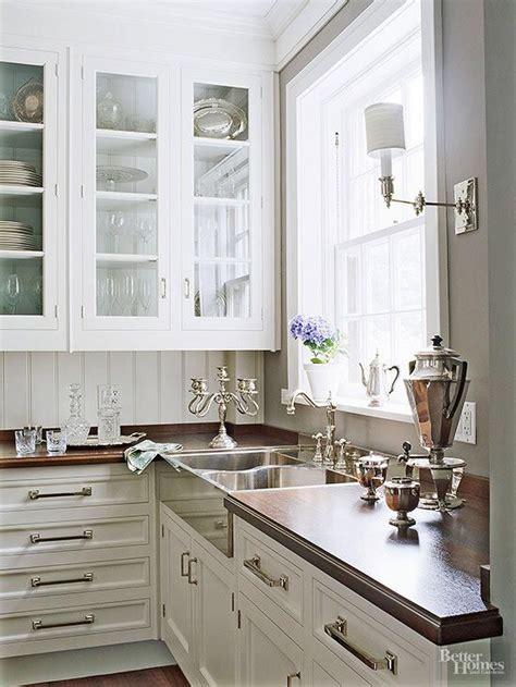 white kitchen  wood countertops stainless farmhouse