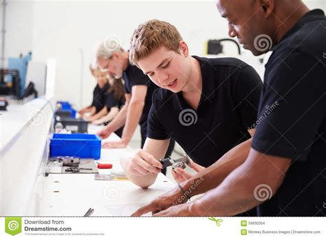 Component Engineer by Apprentice Engineer Measuring Component With Micrometer Royalty Free Stock Image Cartoondealer