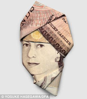 Money Origami Uk - gandhi in a baseball cap and the in a turban it